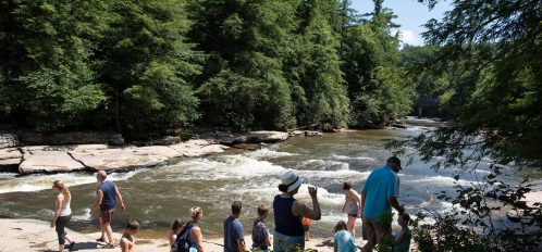 Deep Creek Lake MD Swallow Falls people on rocks by stream