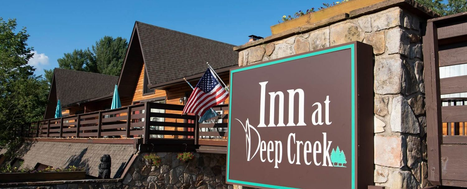 Inn at Deep Creek exterior front welcome sign