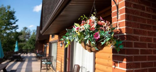 Inn at Deep Creek exterior second level deck floral closeup