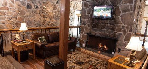 Inn at Deep Creek lobby stone fireplace common area