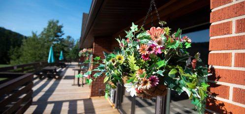 Inn at Deep Creek second level floral basket closeup
